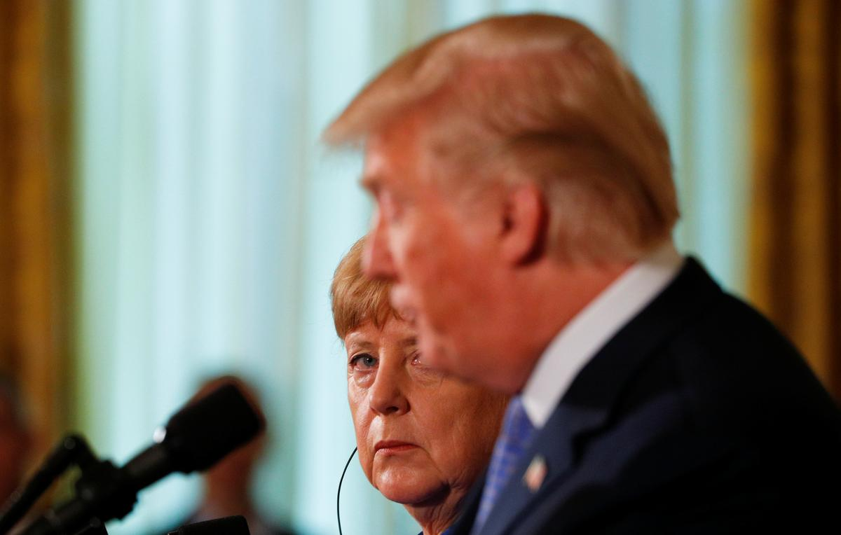 Trump trade threat looms large as Merkel heads to China
