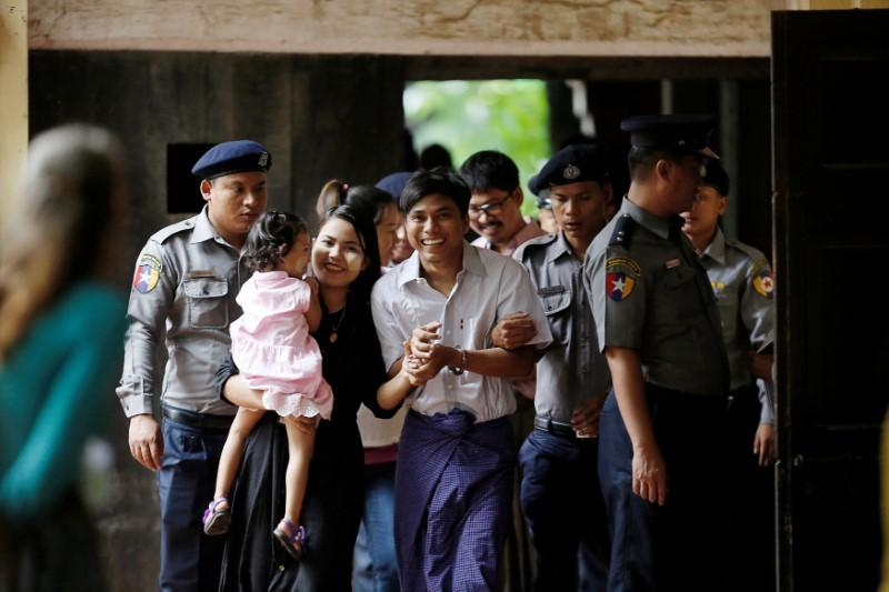 32c3067d1093 FILE PHOTO  Detained Reuters journalist Kyaw Soe Oo arrives at Insein court  in Yangon