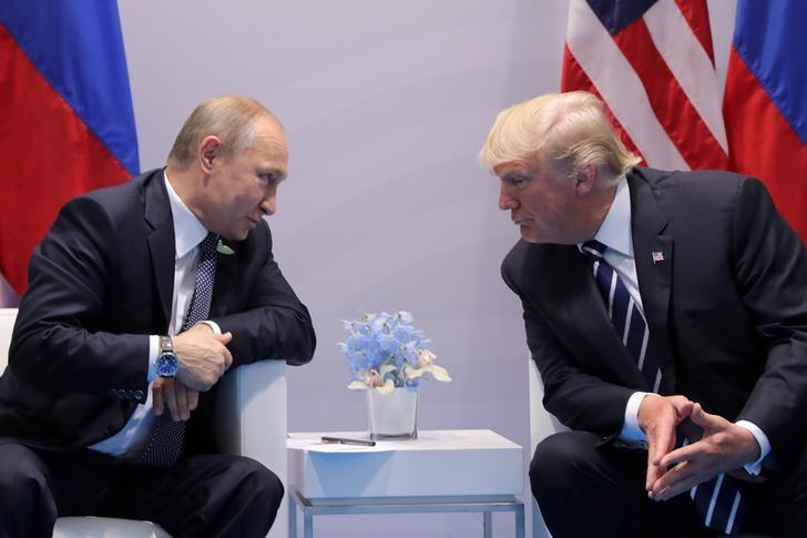 Russia's President Vladimir Putin and U.S. President Donald Trump, pictured here during a bilateral meeting at the G20 summit in Hamburg, Germany July 7, 2017, will meet in Helsinki on July 16, 2018.   Carlos Barria