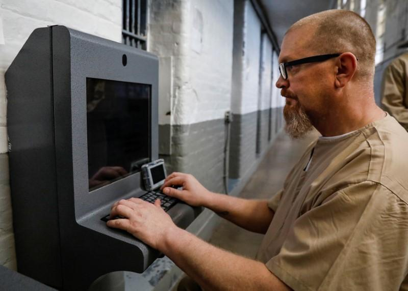 In U S  prisons, tablets open window to the outside world