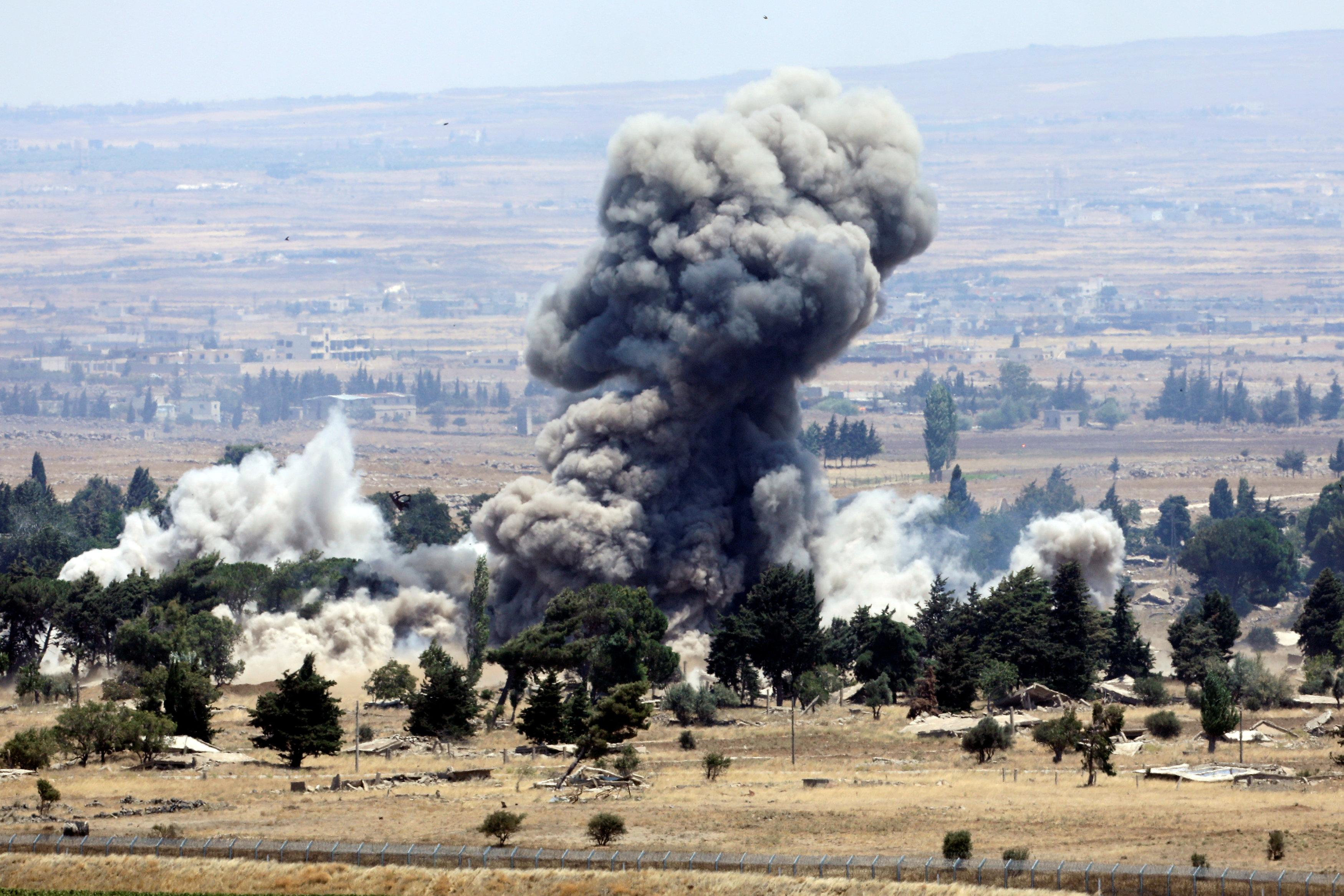 An explosion is pictured at Quneitra at the Syrian side of the Israeli Syrian border, as seen from the Israeli-occupied Golan Heights, Israel July 22, 2018. Ronen Zvulun