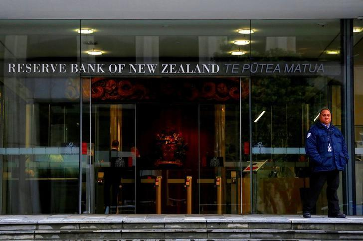 A security guard stands outside the main entrance to the Reserve Bank of New Zealand located in central Wellington, New Zealand, July 3, 2017.  David Gray