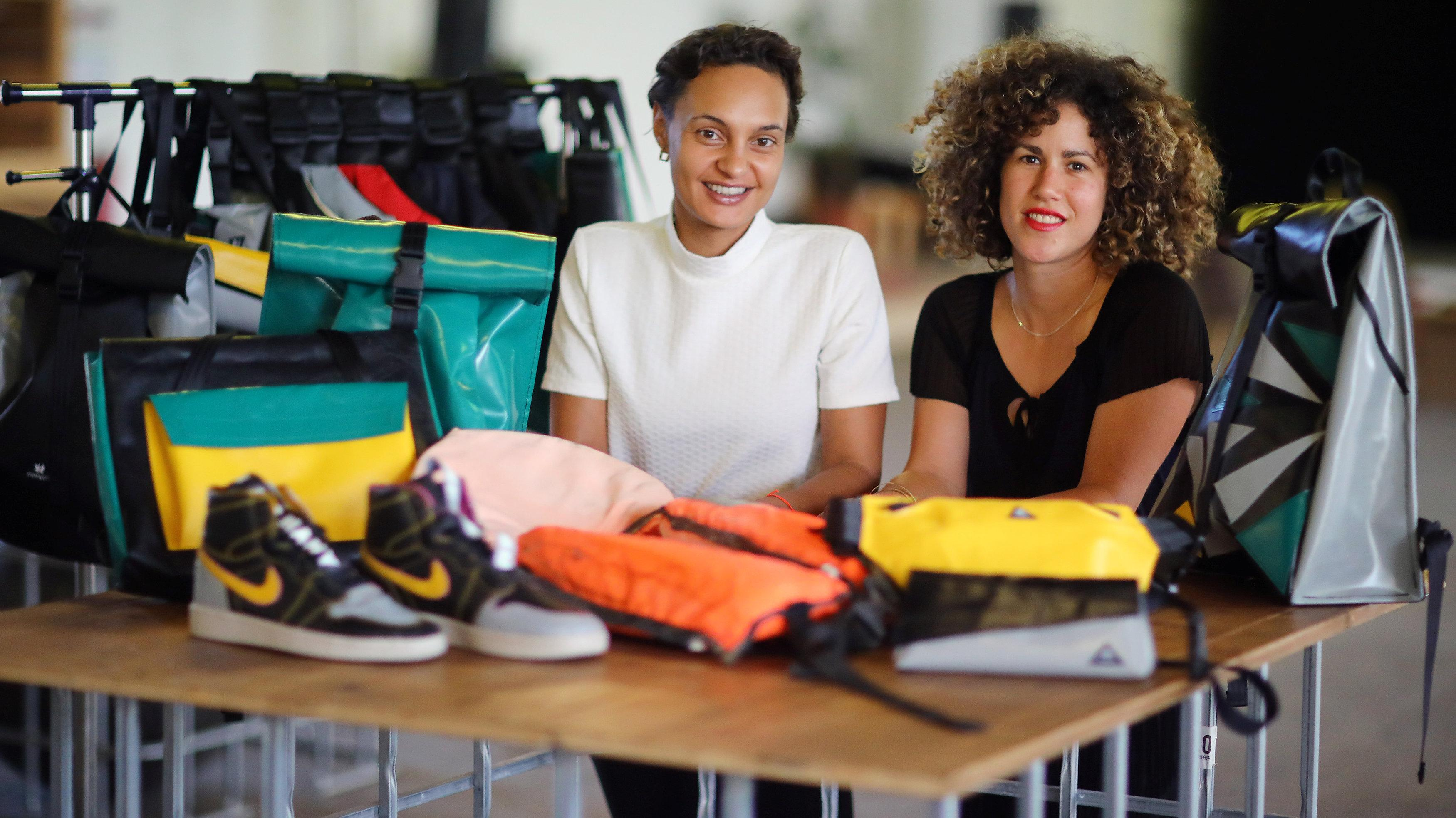 The founders Nora Azzaoui and Vera Guenther are pictured at their non-profit organization Mimycri, which recycles parts of a discarded dinghies into bags, in Berlin, Germany, July 23, 2018. Hannibal Hanschke