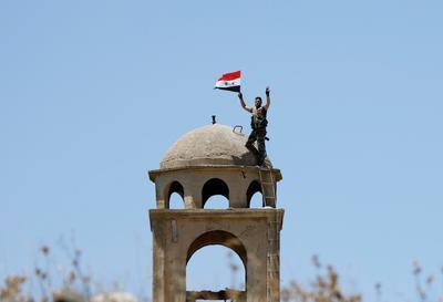 Syrian flag raised in Quneitra