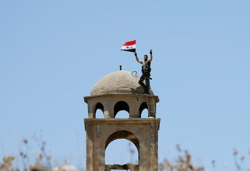 Syrian flag raised in Quneitra