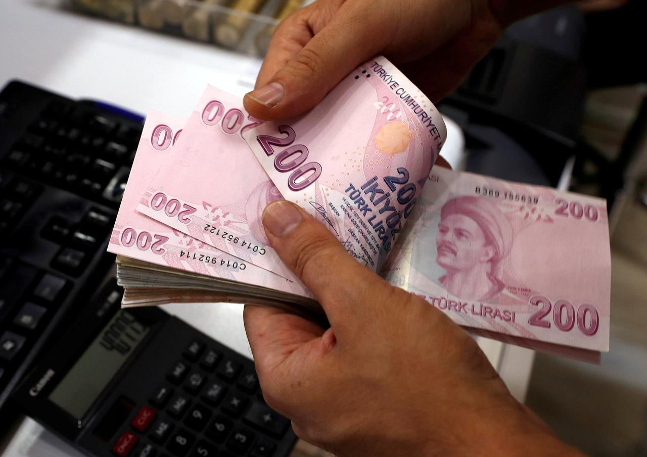 File Photo A Money Changer Counts Turkish Lira Banknotes At Currency Exchange Office In Istanbul Turkey August 2 2018 Reuters Murad Sezer