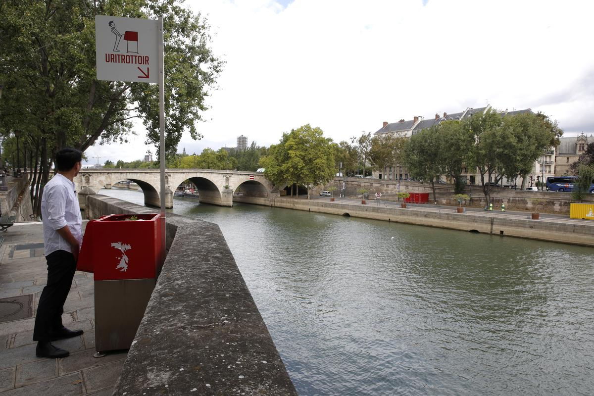 Paris Residents Peeved At Very Public Eco Friendly Urinals Reuters Electrical Wall Outlet Wiring Newhairstylesformen2014com