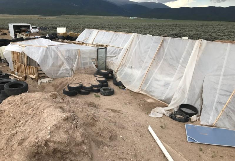 Body found at New Mexico compound identified as missing boy | Reuters