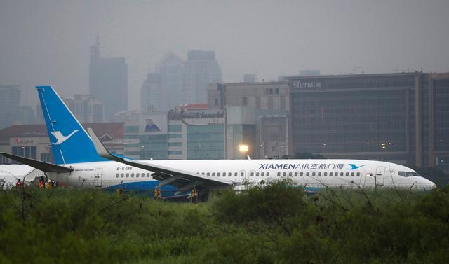 Xiamen Air plane skids off Philippine runway, disrupting flights