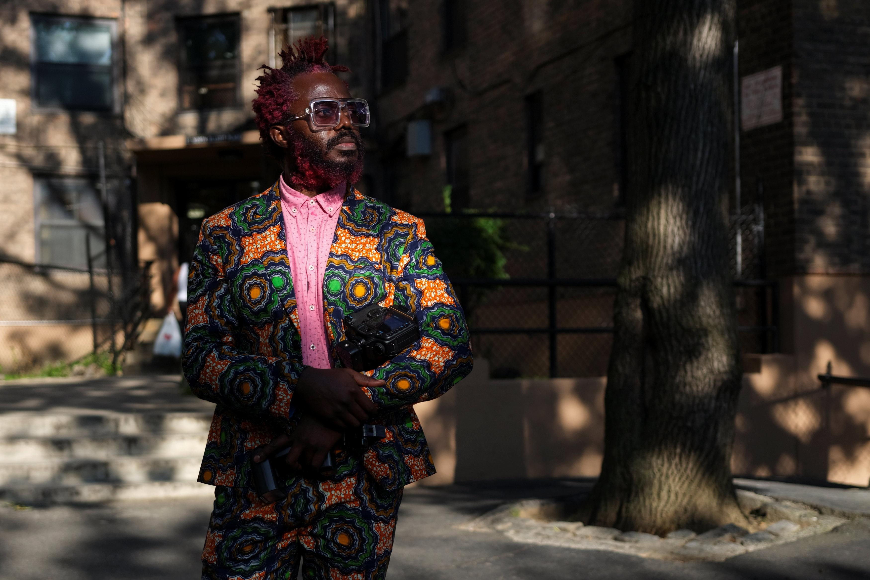 Josiah Esowe, a photographer based in New York, poses for a picture in the Brooklyn borough of New York, U.S., August 25, 2018.   Caitlin Ochs