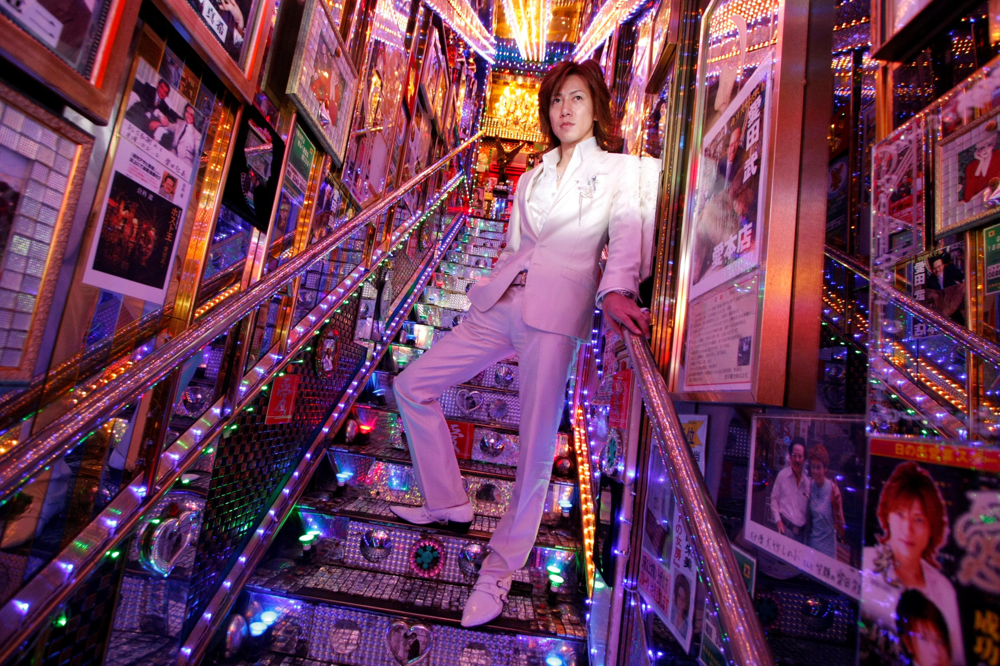 Hikaru Aizawa, who entertains female customers as a host in a club in Tokyo's red light district, poses for a photograph at his host club in Tokyo's Kabukicho nightlife district, Japan, June 25, 2009. Toru Hanai