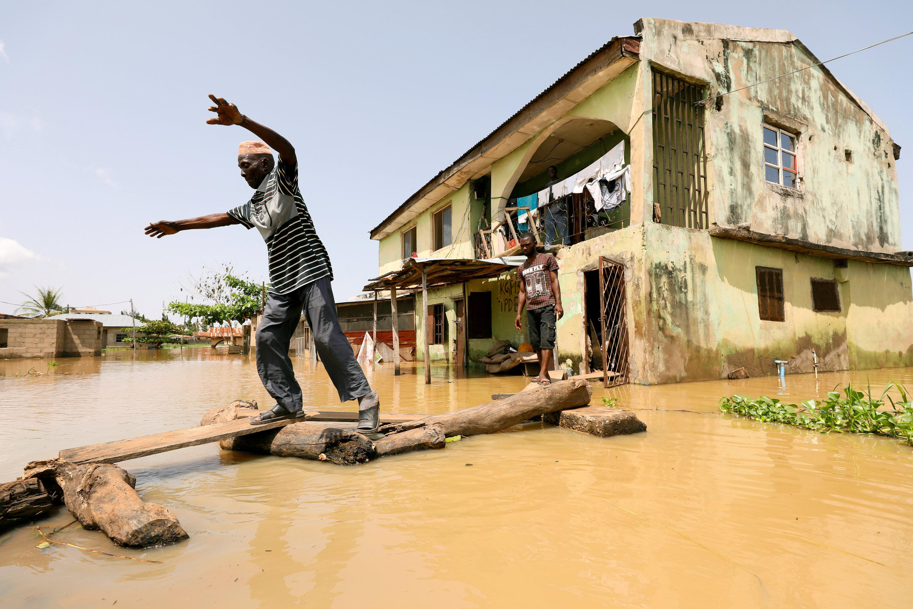 A man makes his way through flood waters in Kogi State, Nigeria September 17, 2018. Afolabi Sotunde