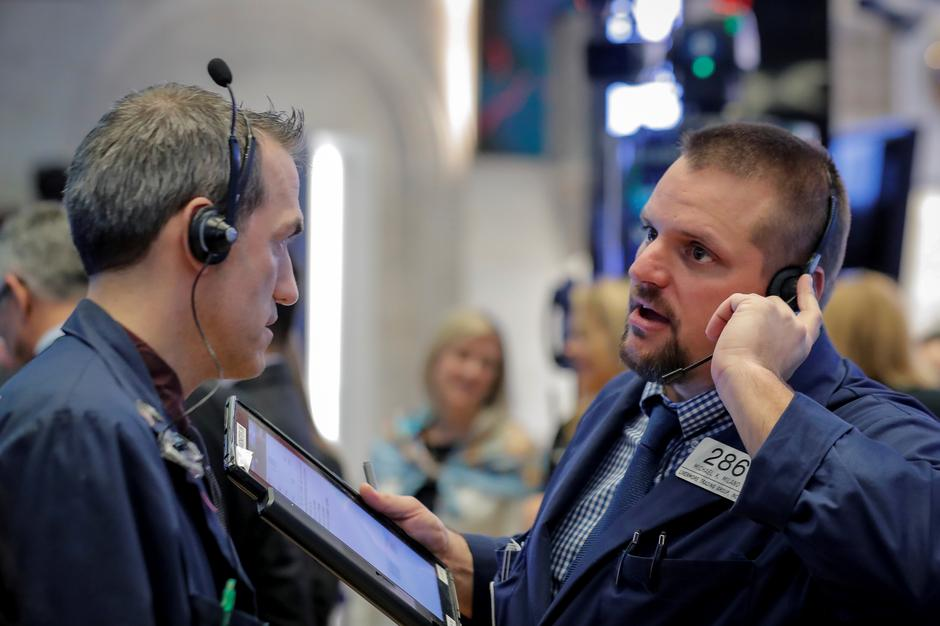Wall St  slides as Saudi Arabia, Italy add to economic