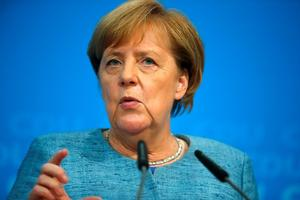 FILE PHOTO: German Chancellor Angela Merkel gives a statement after...
