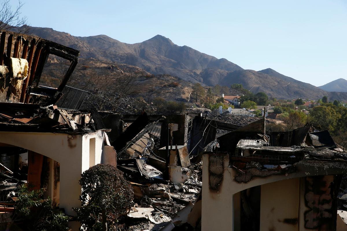 California fire evacuees trickle back to deal with the ashes