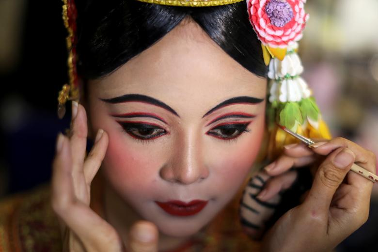 Dancers get ready backstage before a performance of masked theater known as Khon at the Thailand Cultural Centre in Bangkok, Thailand November 7, 2018. The dance was recently listed by UNESCO, the United Nations' cultural agency, as an intangible cultural heritage, along with neighboring Cambodia's version of the dance known as Lakhon Khol. REUTERS/Jorge Silva