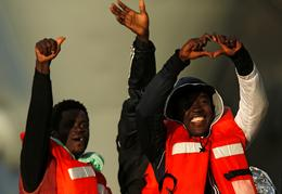 Stranded migrants offered safe port