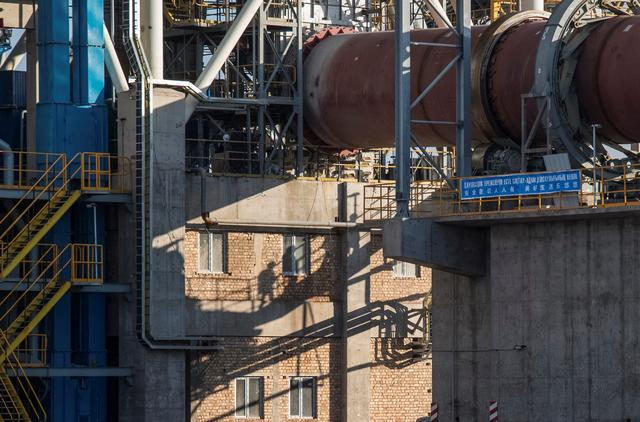 Shuttered at home, cement plants bloom along China's new