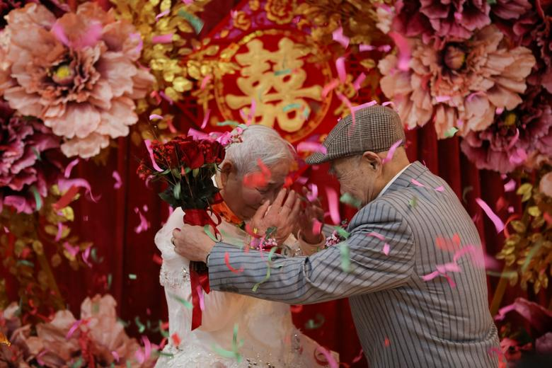 76162a7db372bd Valentine s Day. An elderly couple attends a wedding ceremony that is  recreated for them by local charities on