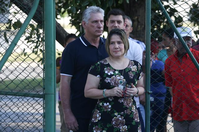 Cuba's President Miguel Diaz-Canel and his wife Lis Cuesta arrive at a polling station to cast their votes during a constitutional referendum in Havana, Cuba, February 24, 2019. REUTERS/Fernando Medina/Pool