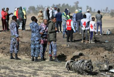 Ethiopian Federal policemen stand near engine parts at the scene of the...