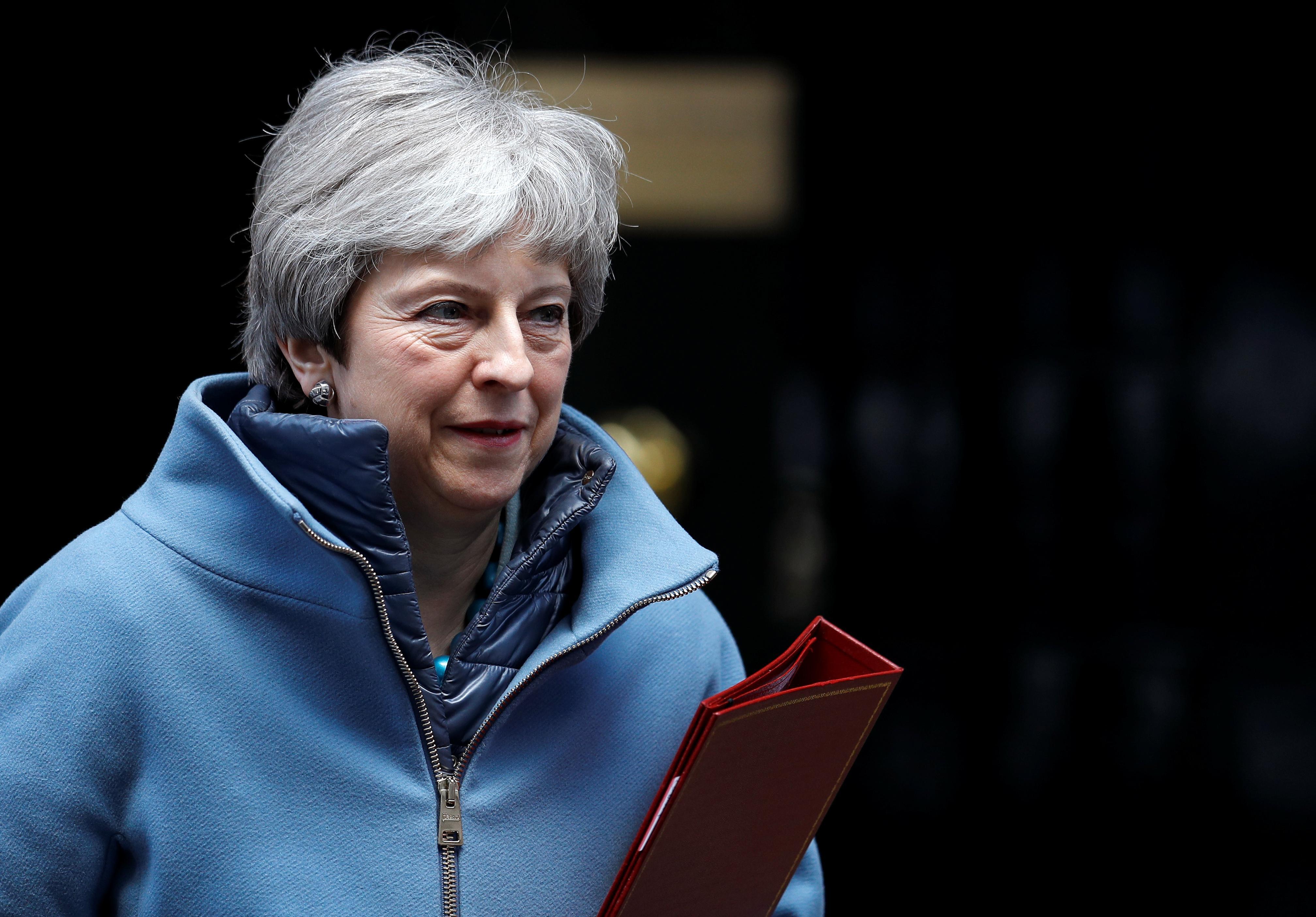 3月27日、英国のメイ首相は議会が3度目の採決で自身の欧州連合(EU)離脱協定案を可決すれば辞任する意向を表明した。25日撮影(2019年 ロイター/PETER NICHOLLS)