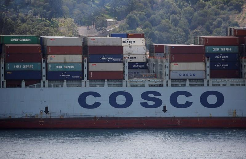 COSCO Shipping flags risks from oil price, trade dispute as