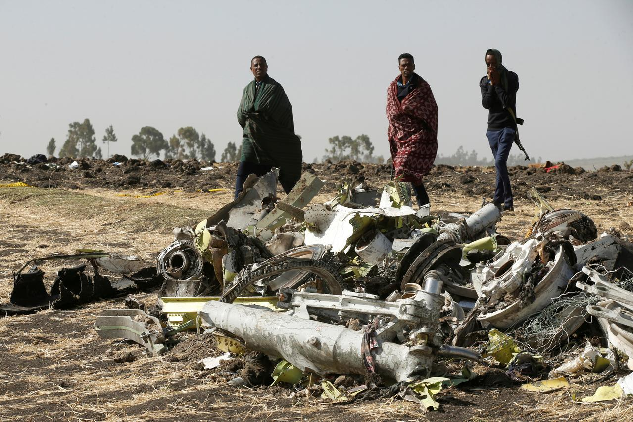 fe9ecba826d0 FILE PHOTO  Ethiopian police officers walk past the debris of the Ethiopian  Airlines Flight ET 302 plane crash