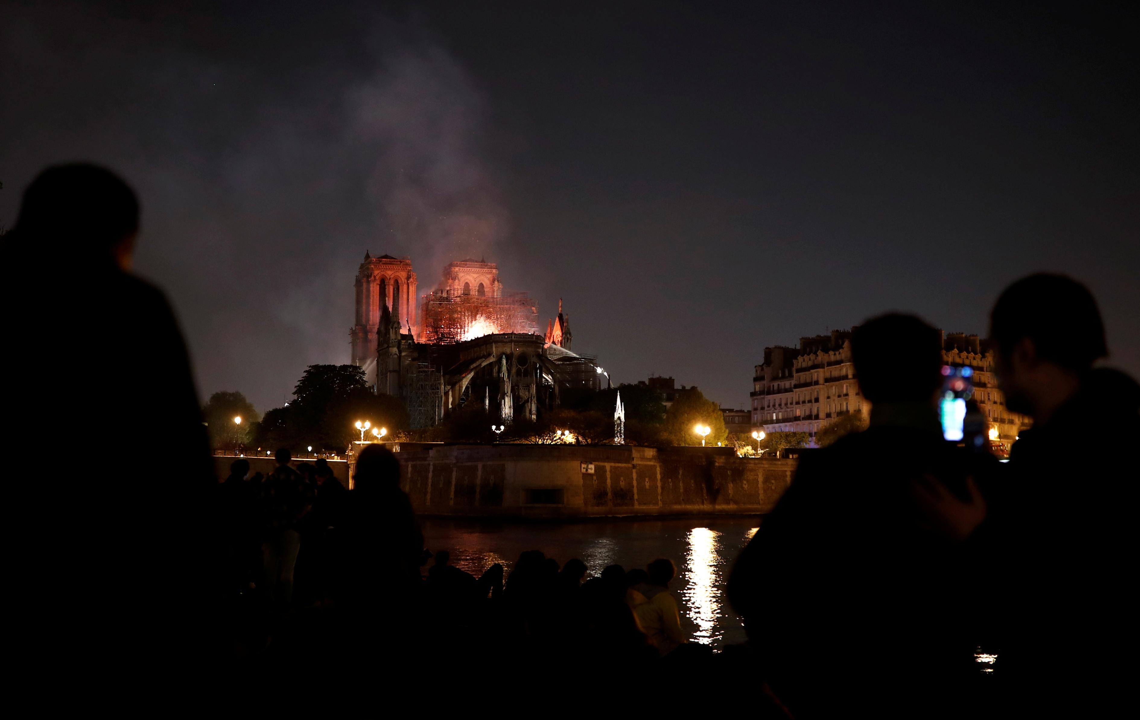 'City of lights' plunged into dark sorrow as Notre-Dame burns