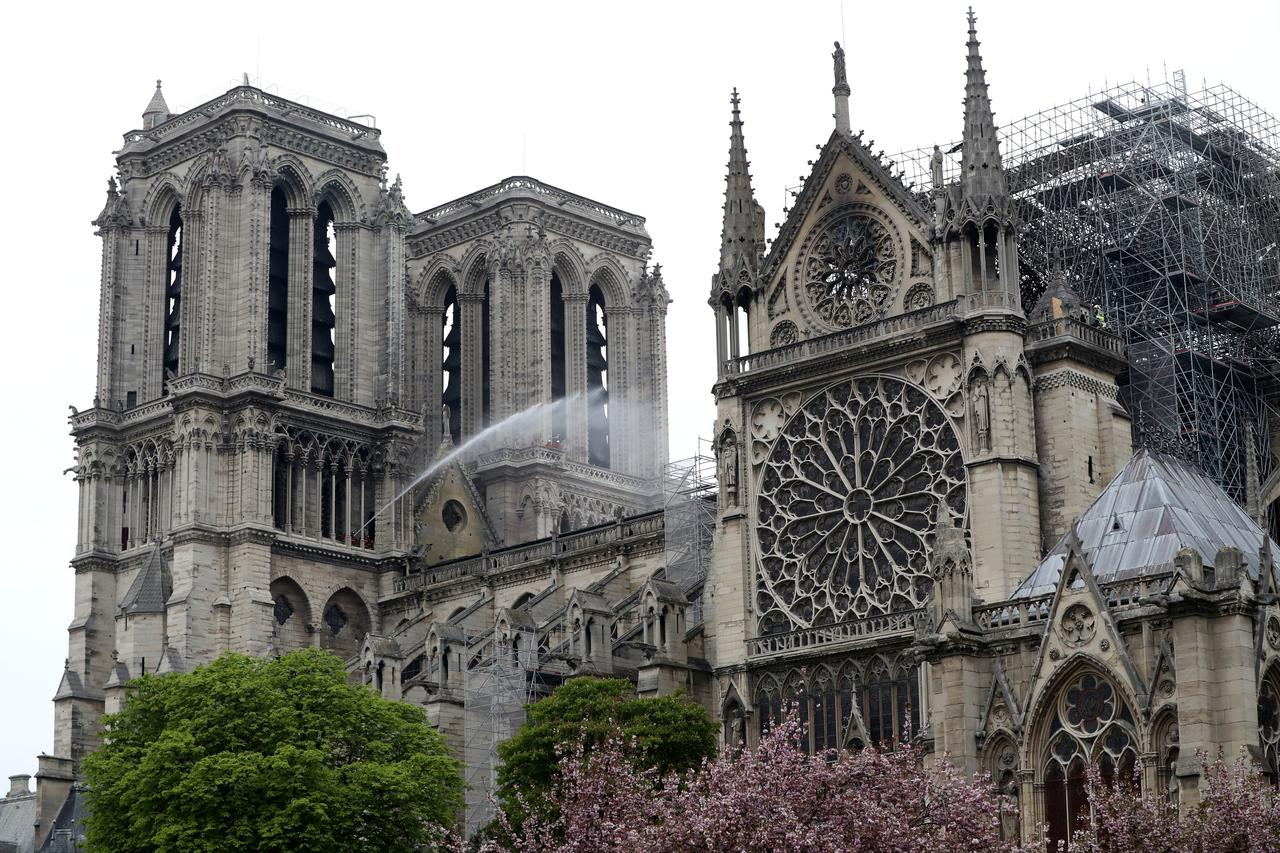 85864417 Firefighters work at Notre-Dame Cathedral after a massive fire devastated  large parts of the gothic gem in Paris, France April 16, 2019. REUTERS/Yves  Herman