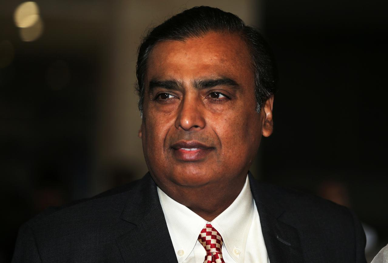 India's richest man backs candidate from main opposition