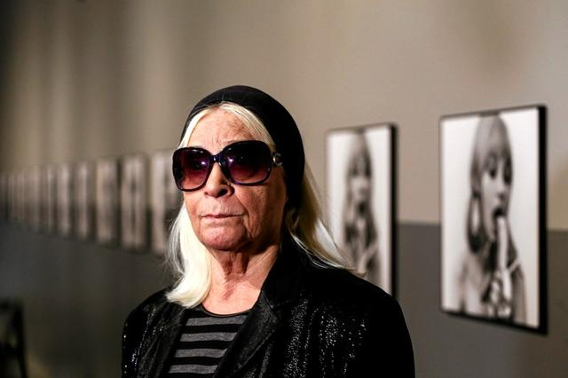 FILE PHOTO: The artist Natalia LL poses in front of her work called 'Consumer Art' at Centre for Contemporary Art in Warsaw, Poland January 1, 2015.  Agencja Gazeta/Adam Stepien/via REUTERS