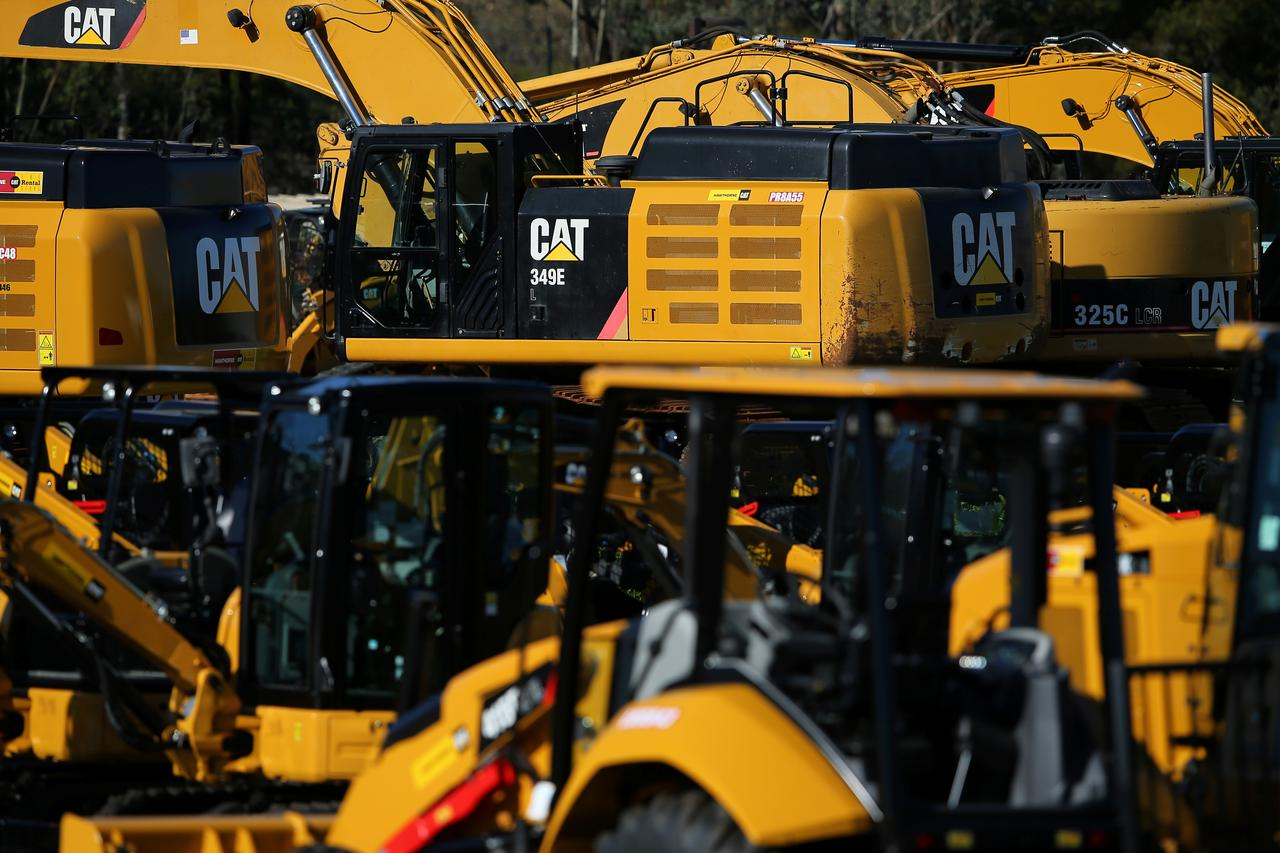 Caterpillar gives details on services push, hikes dividend
