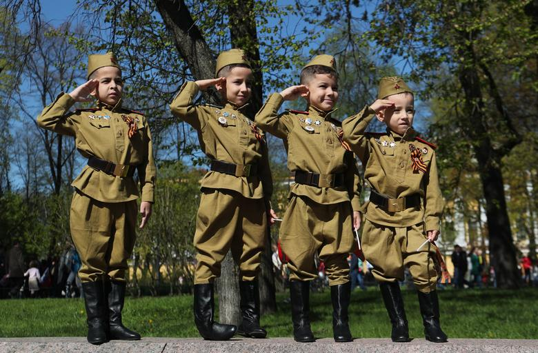 Children in uniforms salute during Victory Day celebrations in St. Petersburg, Russia. REUTERS/Anton Vaganov