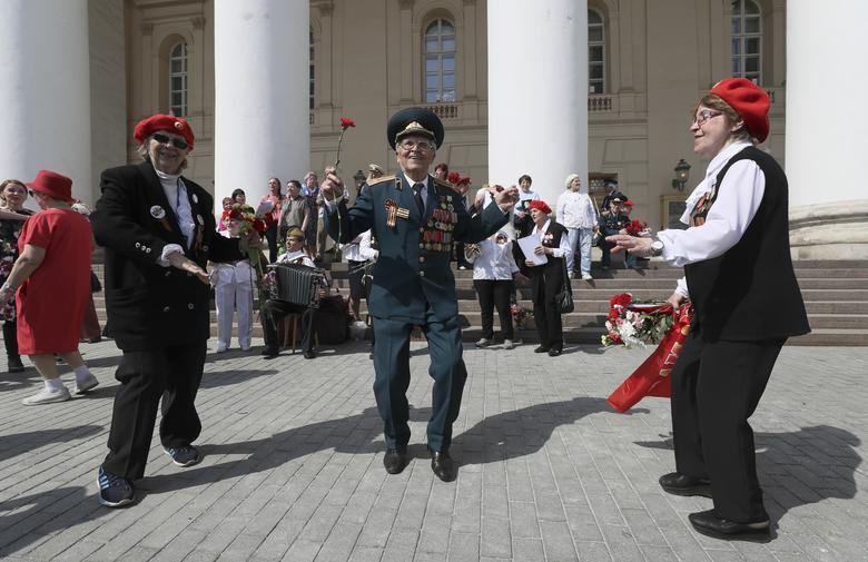 People take part in Victory Day celebrations near the Bolshoi Theatre in central Moscow, Russia. REUTERS/Evgenia Novozhenina