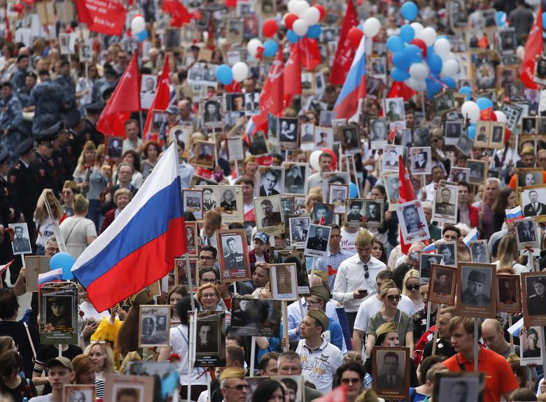 Participants carry portraits of people, including Red Army soldiers, during the Immortal Regiment march on the Victory Day in central Moscow, Russia. REUTERS/Maxim Shemetov