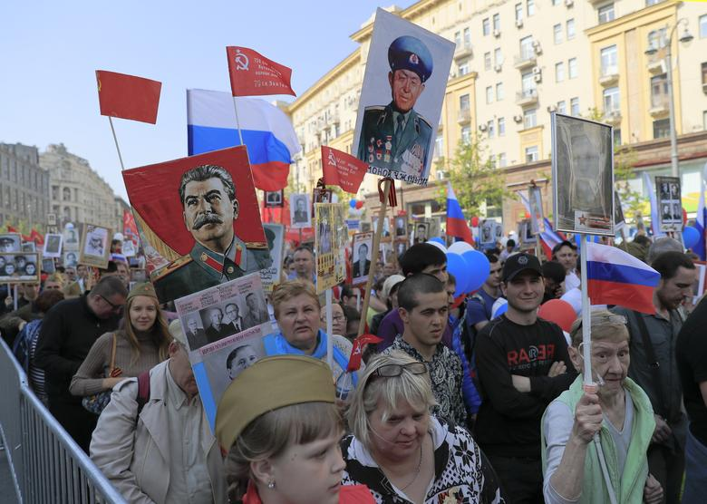 People take part in the Immortal Regiment march during Victory Day celebrations in central Moscow, Russia. REUTERS/Tatyana Makeyeva