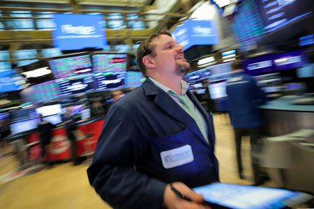 Wall St hit by trade uncertainty; Uber makes tepid debut