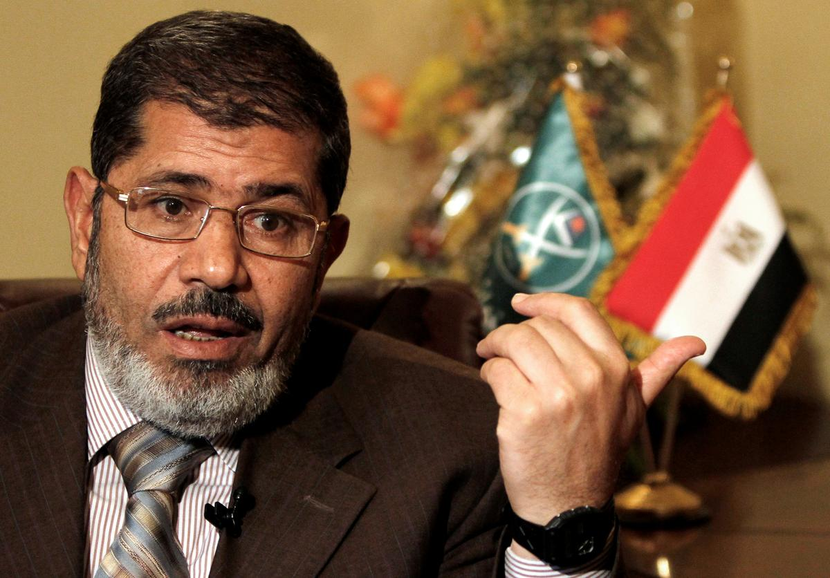 Former Egyptian president Mursi buried in Cairo, son says