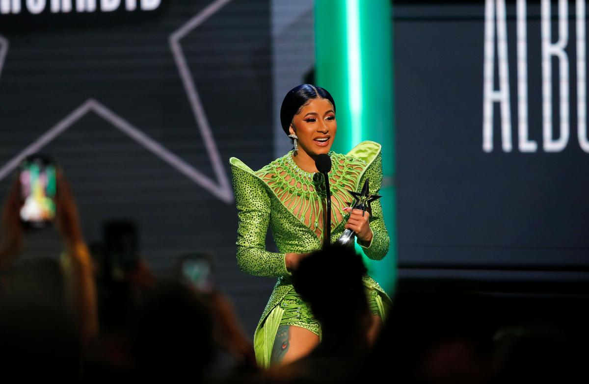 Rapper Cardi B appears in New York court over strip club fight charges