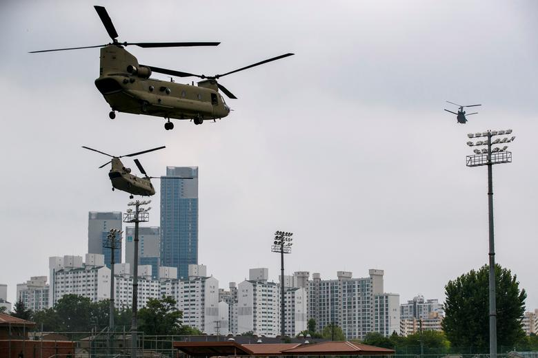 Support helicopters follow the Marine One helicopter carrying President Trump to the demilitarized zone (DMZ) as they take off from Seoul, South Korea. Jacquelyn Martin/Pool via REUTERS