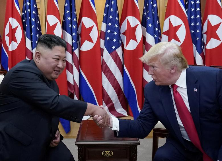 President Trump meets with Kim Jong Un at the demilitarized zone separating the two Koreas, in Panmunjom, South Korea. Trump tweeted the invitation only on Saturday to Kim to join him as he toured the DMZ, a meeting he had said would probably last only for a couple of minutes for a symbolic handshake across the line. The spur-of-the-moment idea apparently caught Kim by surprise, but he was quick to reciprocate.REUTERS/Kevin Lamarque