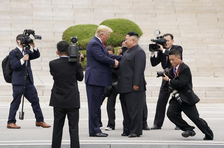 President Trump meets with Kim Jong Un at the demilitarized zone separating the two Koreas, in Panmunjom, South Korea. The chaotic scene of reporters and secret service bumping into each other highlighted how little planning had gone into the hastily arranged encounter.REUTERS/Kevin Lamarque
