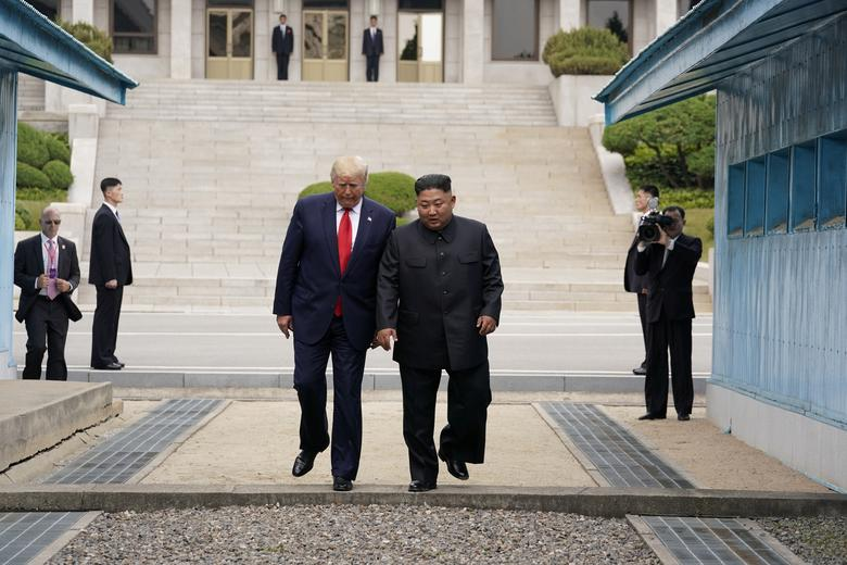 U.S. President Donald Trump meets with North Korean leader Kim Jong Un at the demilitarized zone separating the two Koreas, in Panmunjom, South Korea, June 30, 2019. President Trump took a historic step into North Korea, drawing on his penchant for showmanship and surprise to pull off talks with Kim Jong Un in the Demilitarized Zone (DMZ) that divides the two Koreas.REUTERS/Kevin Lamarque