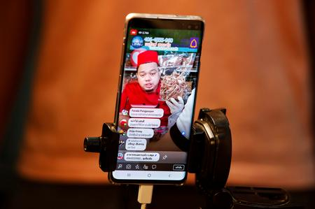 From shrimp to fake eyelashes, social media sales soar in Facebook-friendly Thailand
