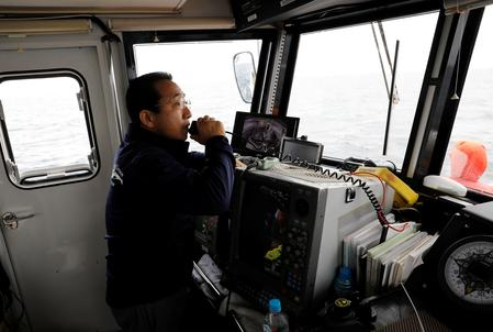 Former Japanese fisherman finds profit in whale-watching