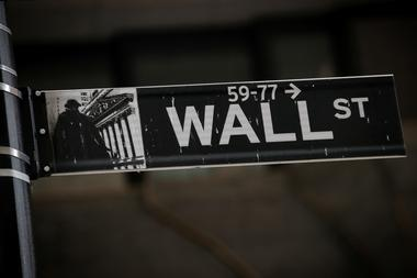 A Wall St. street sign is seen near the New York Stock Exchange (NYSE) in...