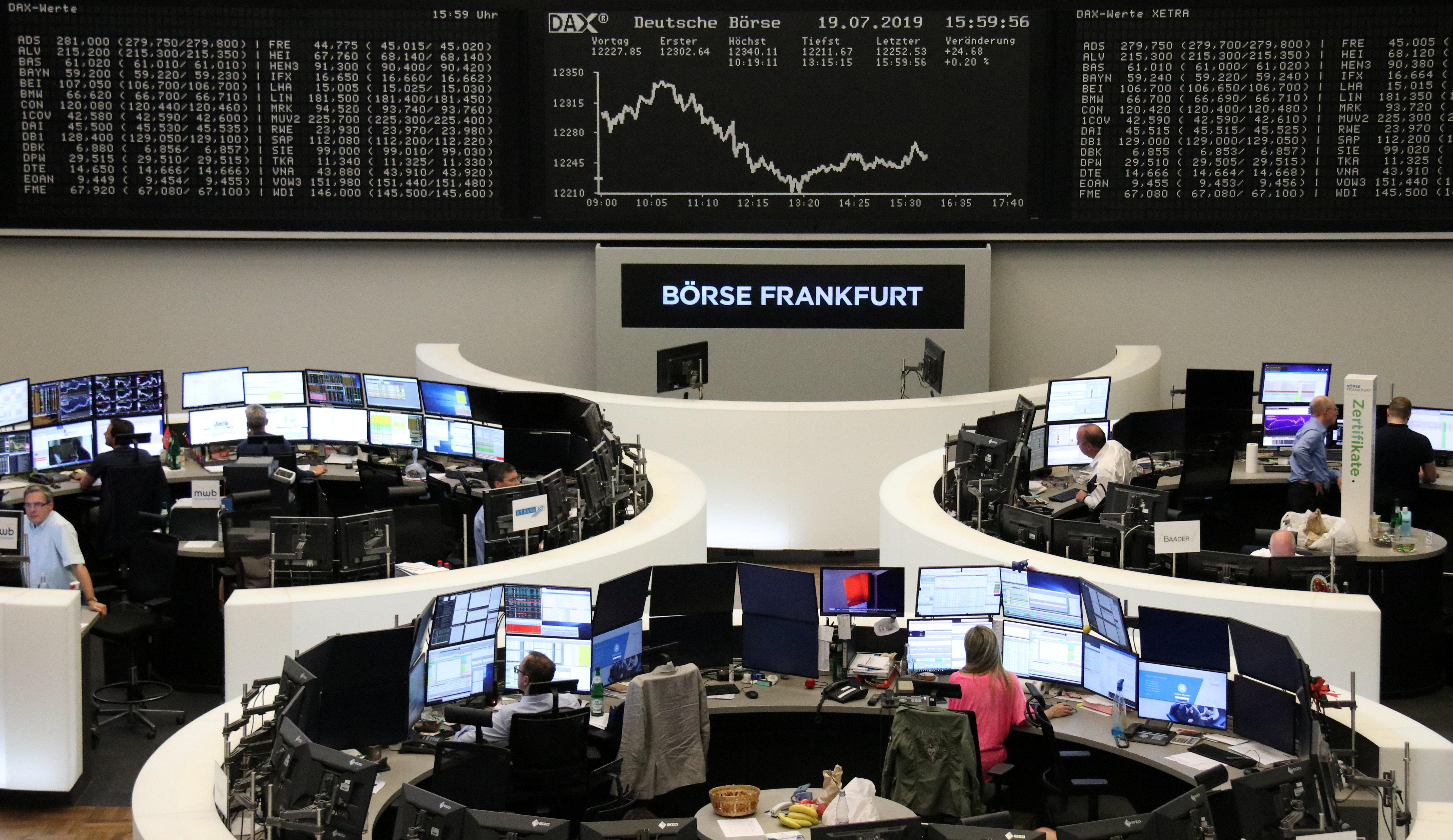 European stocks end quiet trading session barely up