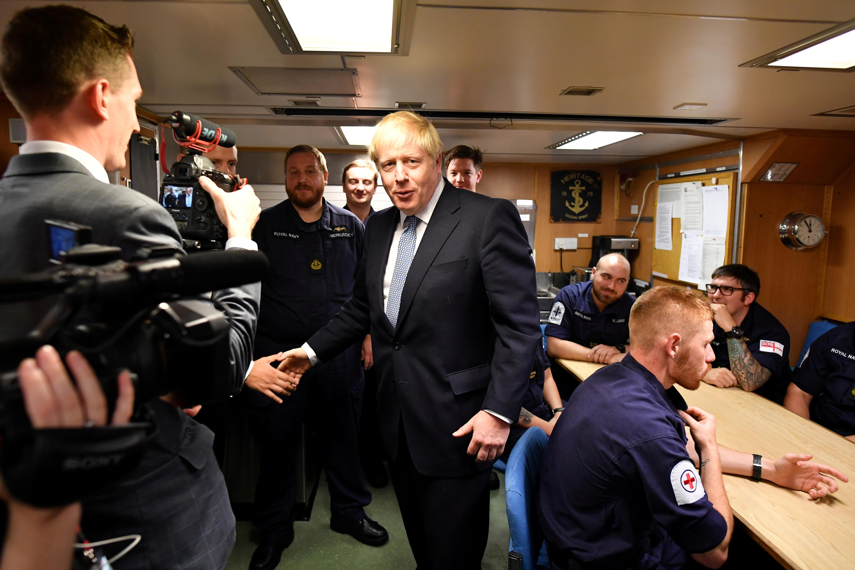 UK plays Brexit hardball from a submarine base, pound tumbles