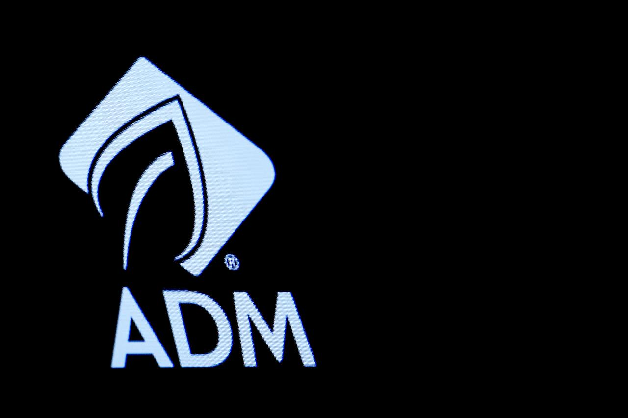 ADM profit plunges as floods, U S -China trade war batter grain